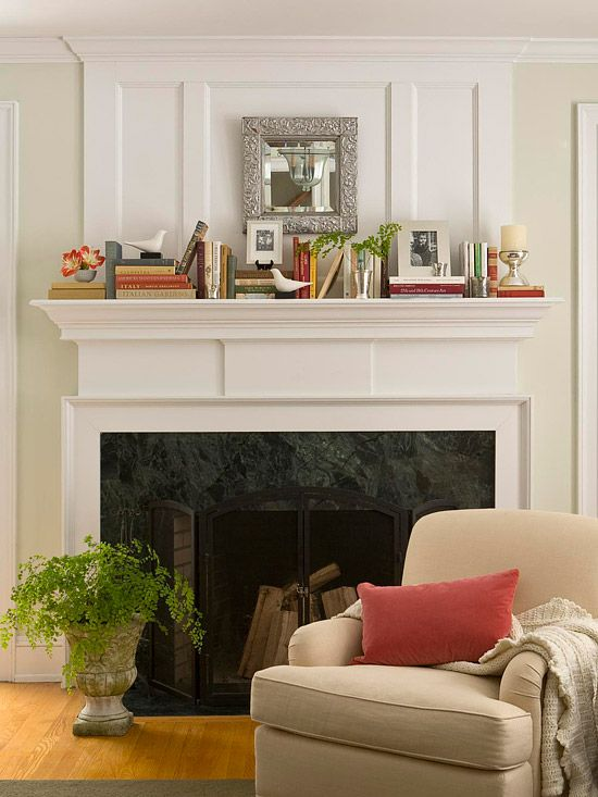 books on mantle with mirror